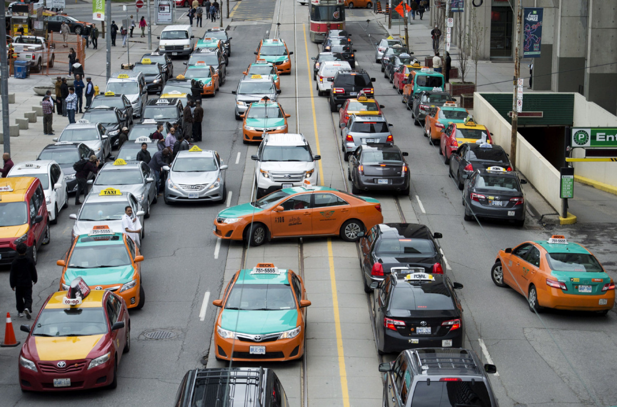 Taxi drivers protest Uber in Toronto on Monday, June 1, 2015. The City of Toronto and ride-sharing service Uber are in court Monday over the legality of the company's operations. The city is seeking a permanent injunciton to shut down Uber's services. THE CANADIAN PRESS/Nathan Denette