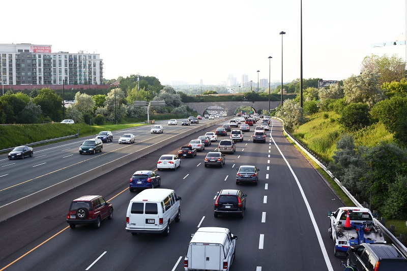 Toronto, Ontario, Canada - June 26, 2013: Traffic on Toronto Don Valley Parkway (DVP) highway in the evening with CAA tow truck on the right.